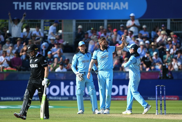 England's Liam Plunkett (2R) celebrates with teammate Jos Buttler (2L) and captain Eoin Morgan (R) after the dismissal of New Zealand's Tom Latham (L) during the 2019 Cricket World Cup group stage match between England and New Zealand at the Riverside Ground, in Chester-le-Street, northeast England, on July 3, 2019. (Photo by Paul ELLIS / AFP) / RESTRICTED TO EDITORIAL USE        (Photo credit should read PAUL ELLIS/AFP/Getty Images)
