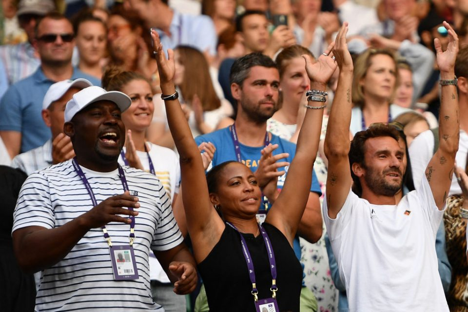 The team of US player Cori Gauff, including her father Corey (L), mother Candi (C) and French tennis coach Jean-Christophe Faurel (R) celebrate after Gauff beat Slovenia's Polona Hercog during their women's singles third round match on the fifth day of the 2019 Wimbledon Championships at The All England Lawn Tennis Club in Wimbledon, southwest London, on July 5, 2019. (Photo by Daniel LEAL-OLIVAS / AFP) / RESTRICTED TO EDITORIAL USE        (Photo credit should read DANIEL LEAL-OLIVAS/AFP/Getty Images)