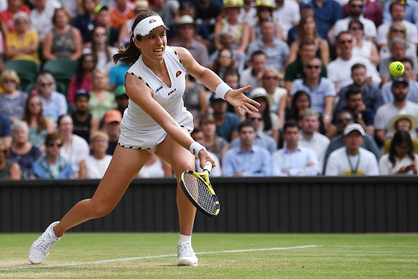 Britain's Johanna Konta returns against Czech Republic's Petra Kvitova during their women's singles fourth round match on the seventh day of the 2019 Wimbledon Championships at The All England Lawn Tennis Club in Wimbledon, southwest London, on July 8, 2019. (Photo by Ben STANSALL / AFP) / RESTRICTED TO EDITORIAL USE        (Photo credit should read BEN STANSALL/AFP/Getty Images)