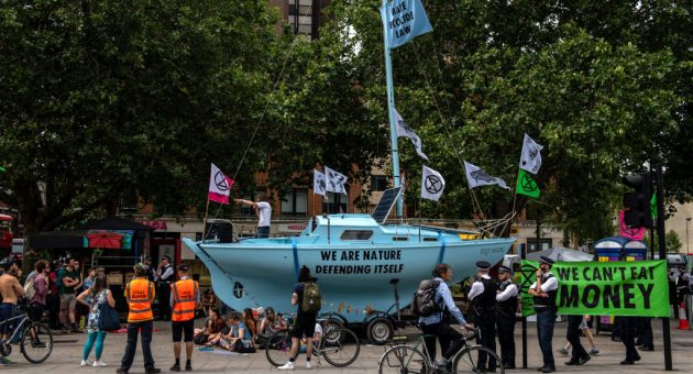 Extinction Rebellion's boats are daubed in slogans and symbols of the protest movement