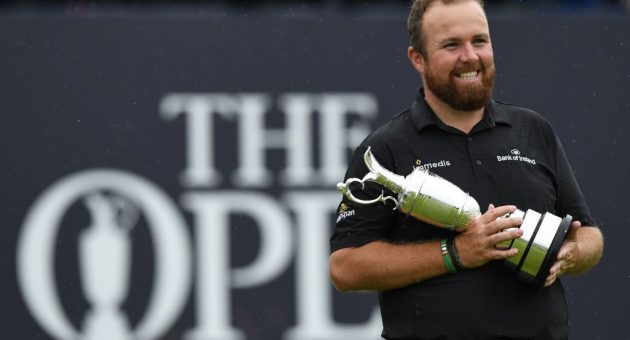 Ireland's Shane Lowry poses with the Claret Jug, the trophy for the Champion golfer of the year after winning the British Open golf Championships at Royal Portrush golf club in Northern Ireland on July 21, 2019. (Photo by Glyn KIRK / AFP) / RESTRICTED TO EDITORIAL USE (Photo credit should read GLYN KIRK/AFP/Getty Images)
