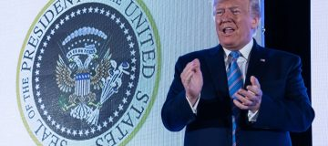 Golf clubs, cash and Russia: Trump makes speech in front of doctored seal