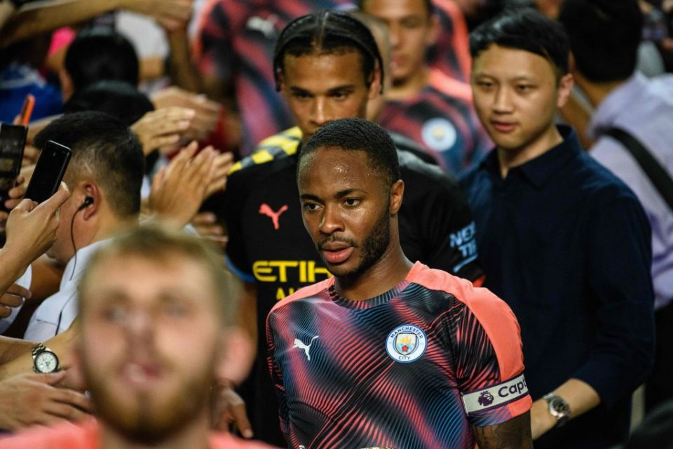 Manchester City's British forward  Raheem Sterling (C) leaves the podium with his teammates  at the end of the friendly football match between English Premier League club Manchester City and Hong Kong's Kitchee at the Hong Kong Stadium, in Hong Kong on July 24, 2019. (Photo by Anthony WALLACE / AFP)        (Photo credit should read ANTHONY WALLACE/AFP/Getty Images)