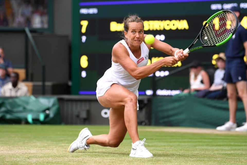 LONDON, ENGLAND - JULY 09: Barbora Strycova of Czech Republic plays a backhand in her Ladies' Singles Quarter Final match against Johanna Konta of Great Britain during Day Eight of The Championships - Wimbledon 2019 at All England Lawn Tennis and Croquet Club on July 09, 2019 in London, England. (Photo by Laurence Griffiths/Getty Images)