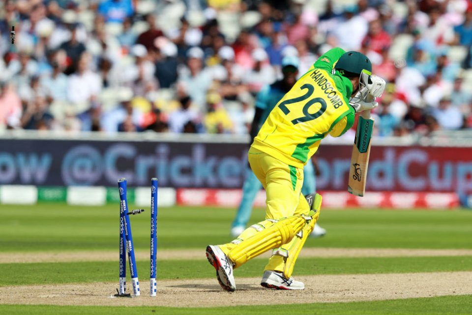 BIRMINGHAM, ENGLAND - JULY 11:  Peter Handscomb of Australia is bowled by Chris Woakes of England during the Semi-Final match of the ICC Cricket World Cup 2019 between Australia and England at Edgbaston on July 11, 2019 in Birmingham, England. (Photo by David Rogers/Getty Images)