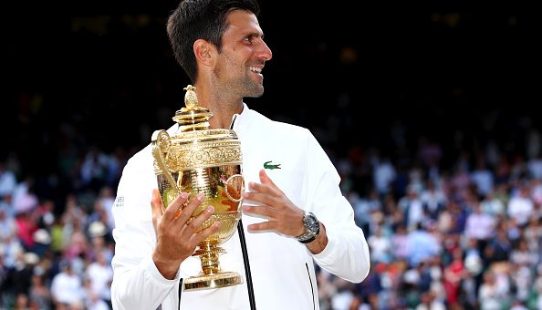 LONDON, ENGLAND - JULY 14: Novak Djokovic of Serbia poses for a photo with the trophy after winning his Men's Singles final against Roger Federer of Switzerland during Day thirteen of The Championships - Wimbledon 2019 at All England Lawn Tennis and Croquet Club on July 14, 2019 in London, England. (Photo by Clive Brunskill/Getty Images)