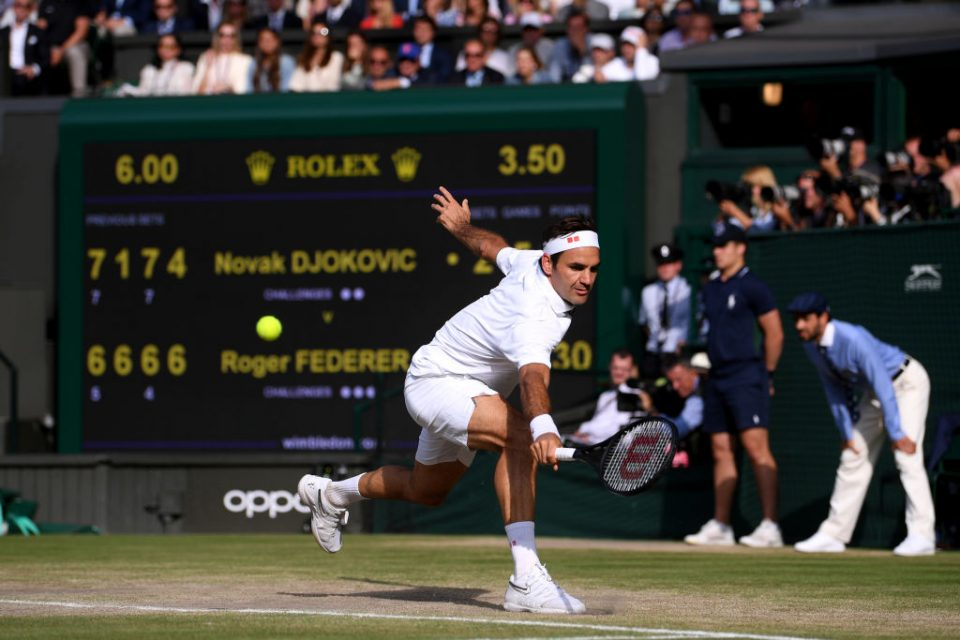 LONDON, ENGLAND - JULY 14: Roger Federer of Switzerland plays a backhand in his Men's Singles final against Novak Djokovic of Serbia during Day thirteen of The Championships - Wimbledon 2019 at All England Lawn Tennis and Croquet Club on July 14, 2019 in London, England. (Photo by Laurence Griffiths/Getty Images)