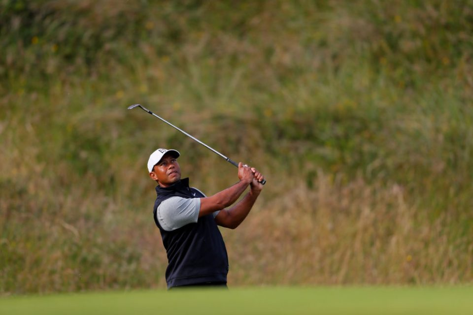 PORTRUSH, NORTHERN IRELAND - JULY 16: Tiger Woods of the United States plays a shot during a practice round prior to the 148th Open Championship held on the Dunluce Links at Royal Portrush Golf Club on July 16, 2019 in Portrush, United Kingdom. (Photo by Kevin C. Cox/Getty Images)