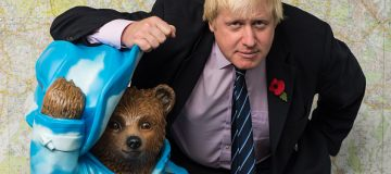 LONDON, ENGLAND - NOVEMBER 03: Boris Johnson stands with his 'Bear of London' Paddington Bear statue during the launch of The Paddington Trail at City Hall on November 3, 2014 in London, England. (Photo by Ian Gavan/Getty Images)