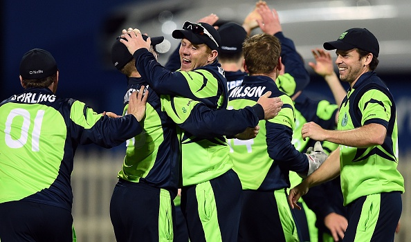 Ireland cricketers celebrate after winning at the Bellerive Oval ground during the 2015 Cricket World Cup Pool B match between Ireland and Zimbabwe in Hobart on March 7, 2015.  AFP PHOTO / INDRANIL MUKHERJEE  -- IMAGE RESTRICTED TO EDITORIAL USE - STRICTLY NO COMMERCIAL USE--        (Photo credit should read INDRANIL MUKHERJEE/AFP/Getty Images)
