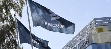 Flags with the logo of telecoms equipment maker Ericsson flutter outside the company's headquarters in Stockholm on October 4, 2016. Ericsson confirmed recent media reports that it will cut 3,000 jobs in Sweden, including in production, research and development. / AFP / TT News Agency / Maja SUSLIN / Sweden OUT (Photo credit should read MAJA SUSLIN/AFP/Getty Images)