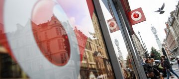 LONDON, ENGLAND - OCTOBER 26: The Vodafone logo is seen on a store front on October 26, 2016 in London, England. Regulator Ofcom has fined Vodafone, who have 20 million mobile customers in the UK, £4.6m for breaching consumer protection rules, the largest fine handed out so far to a telecoms operator. (Photo by Leon Neal/Getty Images)
