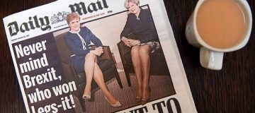 An arranged photograph shows a copy of today's Daily Mail newspaper, pictured in a coffee shop in central London on March 28, 2017, featuring on its front page a picture of Britain's Prime Minister Theresa May and Scotland's First Minister Nicola Sturgeon. Britain's Daily Mail newspaper faced a backlash Tuesday for comparing the legs on show when British Prime Minister Theresa May and Scottish First Minister Nicola Sturgeon held talks. While the two leaders clashed over Brexit, which May is set to trigger Wednesday, and Sturgeon's push for another Scottish independence referendum, the Mail spun it as a battle of the legs and focused on what could be read into their outfits and body language. / AFP PHOTO / Justin TALLIS (Photo credit should read JUSTIN TALLIS/AFP/Getty Images)