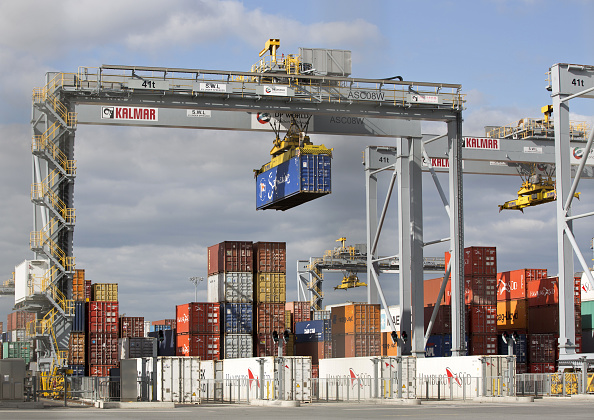 Shipping containers are pictured on the docks at DP World's London Gateway, container port at Corringham, east of London on April 10, 2017. / AFP PHOTO / Isabel Infantes (Photo credit should read ISABEL INFANTES/AFP/Getty Images)