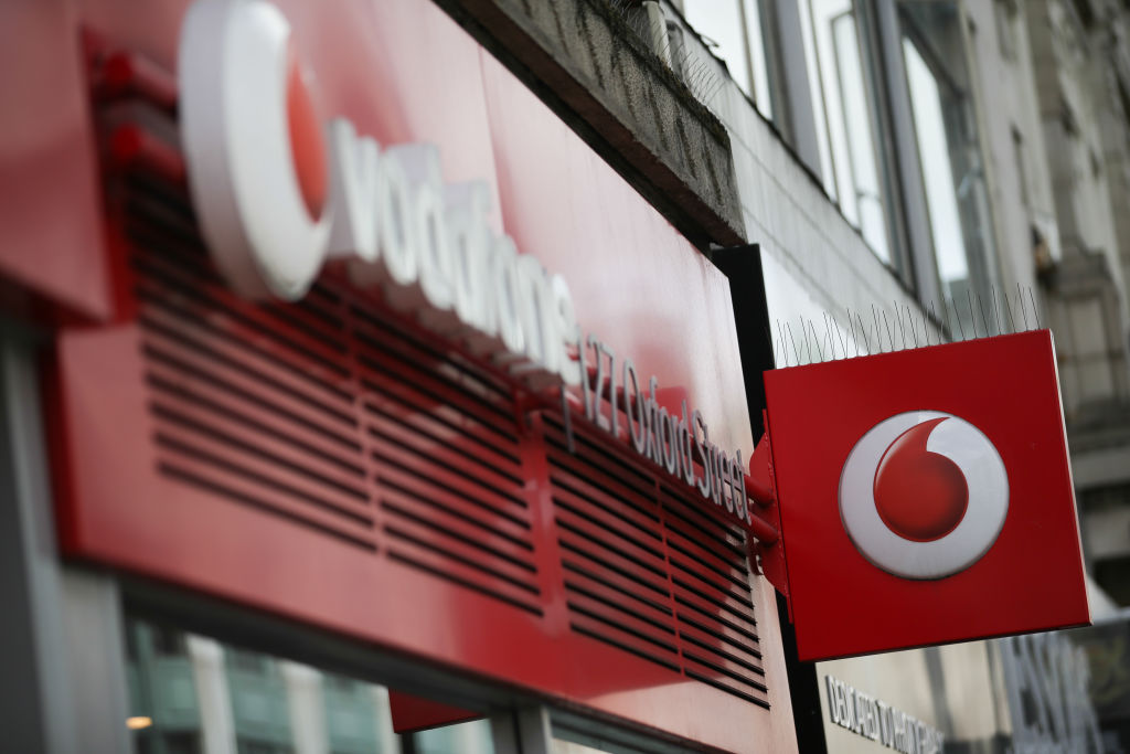 Vodafone chairman defends dividend cut as firm fends off pay revolt
