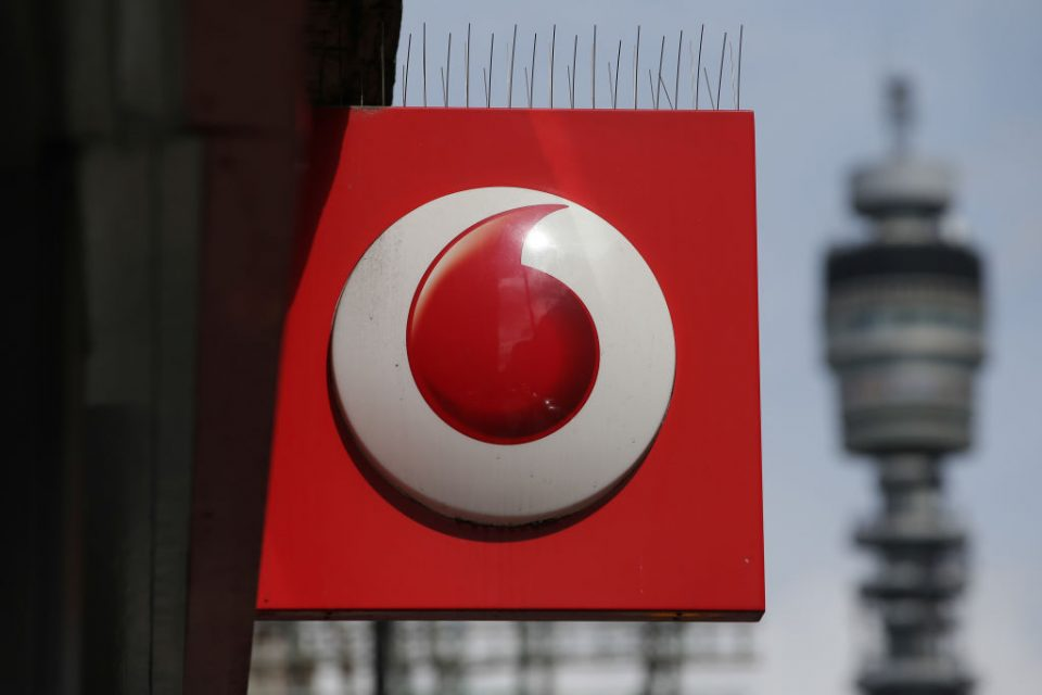 A Vodafone logo is seen at a store in central London on May 16, 2017. Vodafone logged today a large annual net loss after slashing the value of its troubled Indian division, but underlying earnings soared on a solid European performance. / AFP PHOTO / Daniel Leal-Olivas (Photo credit should read DANIEL LEAL-OLIVAS/AFP/Getty Images)