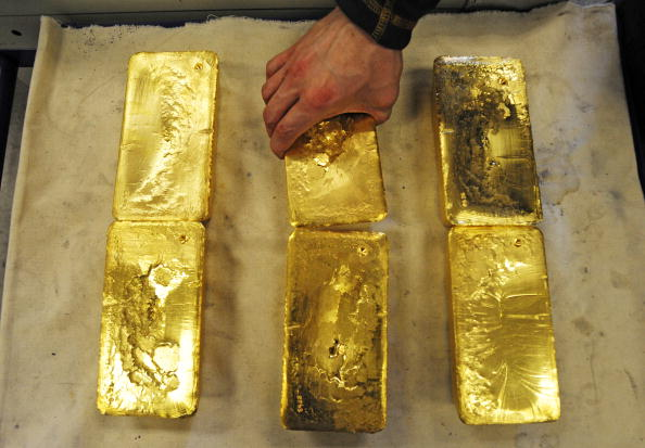 Gold hits six-year high as jittery investors run for safety