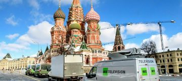 Russia's state-controlled Russia Today (RT) television broadcast vans are seen parked in front of St. Basil's Cathedral and the Kremlin next to Red Square in Moscow on March 16, 2018. Russia will vote for President on March 18. / AFP PHOTO / Mladen ANTONOV (Photo credit should read MLADEN ANTONOV/AFP/Getty Images)