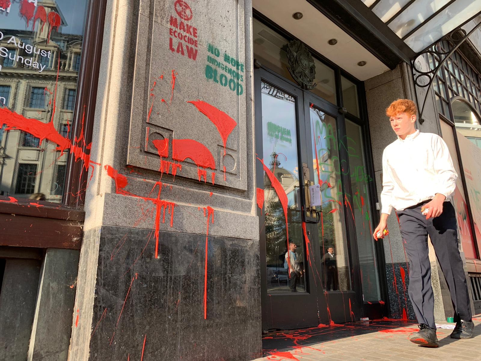 Climate protesters throw red paint at Brazil's London embassy