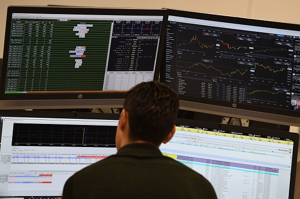 Traders work at the offices of IG markets in the City of London on January 16, 2019. - The pound held its ground today and London's FTSE opened higher after the record defeat of British Prime Minister Theresa May's Brexit plan, as investors consider the next developments in the long-running saga. (Photo by Paul ELLIS / AFP) (Photo credit should read PAUL ELLIS/AFP/Getty Images)
