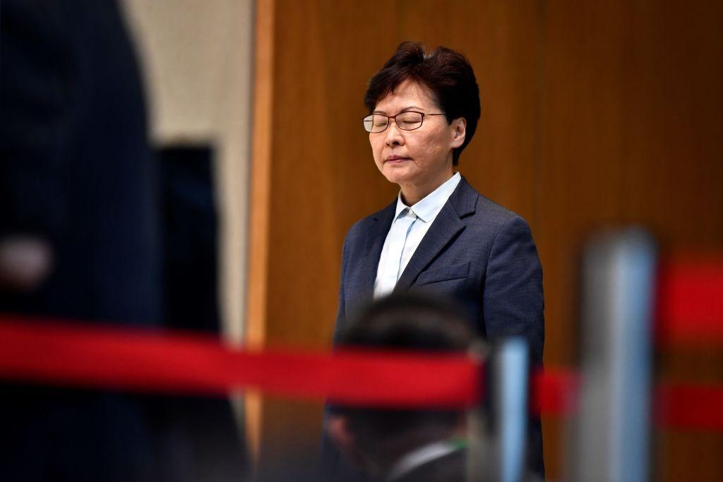 Asian stock markets fall as embattled Hong Kong leader urges calm