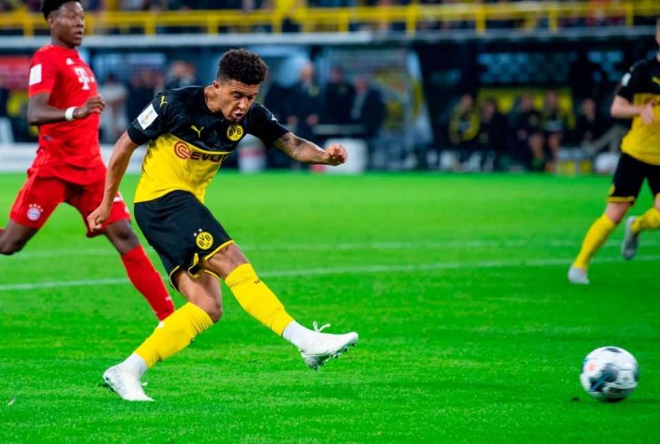 Dortmund's English midfielder Jadon Sancho scores the 2-0 goal during the German Supercup foorball match BVB Borussia Dortmund v FC Bayern Munich on August 3, 2019 at the Signal Iduna Park in Dortmund, western Germany. (Photo by Guido Kirchner / dpa / AFP) / Germany OUT        (Photo credit should read GUIDO KIRCHNER/AFP/Getty Images)