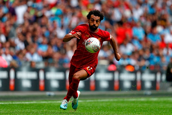 TOPSHOT - Liverpool's Egyptian midfielder Mohamed Salah runs with the ball during the English FA Community Shield football match between Manchester City and Liverpool at Wembley Stadium in north London on August 4, 2019. (Photo by Adrian DENNIS / AFP) / NOT FOR MARKETING OR ADVERTISING USE / RESTRICTED TO EDITORIAL USE (Photo credit should read ADRIAN DENNIS/AFP/Getty Images)