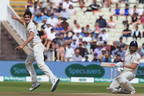 Australia's Pat Cummins (L) appeals having forced England's Jonny Bairstow (R) into gloving a catch to Australia's Cameron Bancroft (not pictured) during play on the fifth day of the first Ashes cricket Test match between England and Australia at Edgbaston in Birmingham, central England on August 5, 2019. (Photo by Lindsey Parnaby / AFP) / RESTRICTED TO EDITORIAL USE. NO ASSOCIATION WITH DIRECT COMPETITOR OF SPONSOR, PARTNER, OR SUPPLIER OF THE ECB (Photo credit should read LINDSEY PARNABY/AFP/Getty Images)