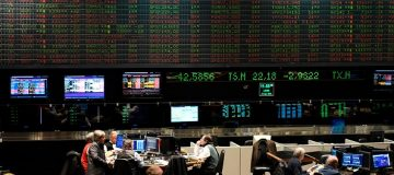 Traders are seen at the Stock Exchange in Buenos Aires on August 12, 2019. - The Buenos Aires stock exchange plunged 10 percent at the start of operations on Monday following liberal President Mauricio Macri's crushing defeat in party primaries over the weekend. Markets reacted with jitters to Macri's massive re-election blow as the peso also went into free fall against the dollar, dropping from 46.55 on Friday to 60. (Photo by RONALDO SCHEMIDT / AFP) (Photo credit should read RONALDO SCHEMIDT/AFP/Getty Images)