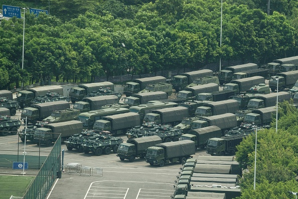Chinese forces exercise on Hong Kong border as Trump suggests meeting with Xi