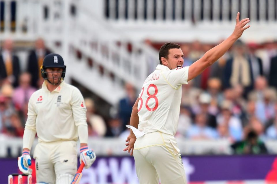 Australia's Josh Hazlewood (R) celebrates taking the wicket of England's Jason Roy (L) for 0 runs on the second day of the second Ashes cricket Test match between England and Australia at Lord's Cricket Ground in London on August 15, 2019. (Photo by Glyn KIRK / AFP) / RESTRICTED TO EDITORIAL USE. NO ASSOCIATION WITH DIRECT COMPETITOR OF SPONSOR, PARTNER, OR SUPPLIER OF THE ECB        (Photo credit should read GLYN KIRK/AFP/Getty Images)