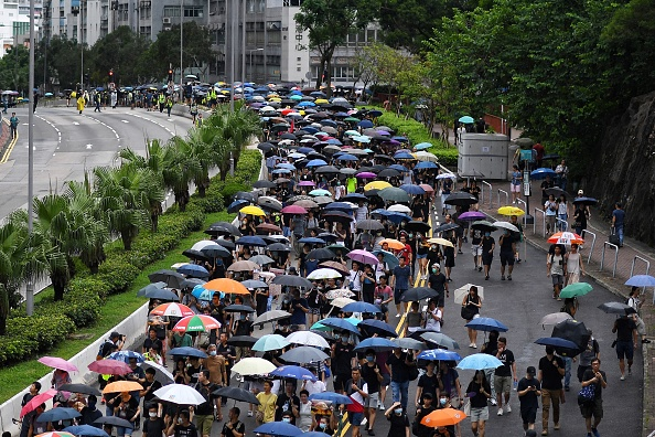 Hong Kong protests: Teachers march against police brutality