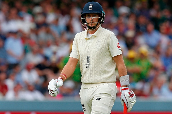 England's captain Joe Root walks back to the pavilion after losing his wicket for no runs during play on the fourth day of the second Ashes cricket Test match between England and Australia at Lord's Cricket Ground in London on August 17, 2019. (Photo by Ian KINGTON / AFP) / RESTRICTED TO EDITORIAL USE. NO ASSOCIATION WITH DIRECT COMPETITOR OF SPONSOR, PARTNER, OR SUPPLIER OF THE ECB        (Photo credit should read IAN KINGTON/AFP/Getty Images)
