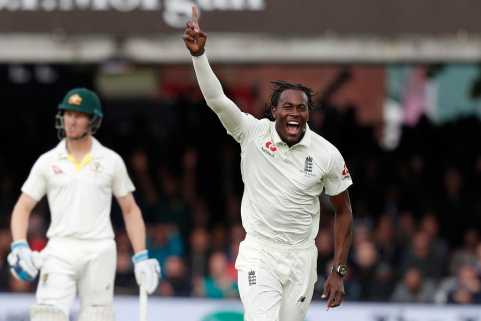 England's Jofra Archer (R) celebrates after taking the wicket of Australia's Usman Khawaja during play on the fifth day of the second Ashes cricket Test match between England and Australia at Lord's Cricket Ground in London on August 18, 2019. (Photo by Adrian DENNIS / AFP) / RESTRICTED TO EDITORIAL USE. NO ASSOCIATION WITH DIRECT COMPETITOR OF SPONSOR, PARTNER, OR SUPPLIER OF THE ECB        (Photo credit should read ADRIAN DENNIS/AFP/Getty Images)