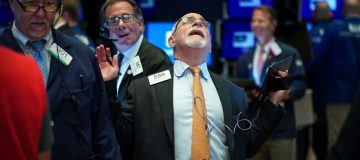 Global stock markets dragged down as recession warning lights flash