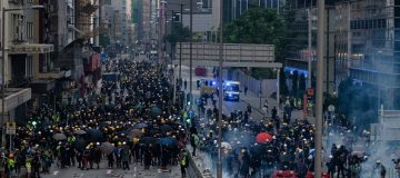 Hong Kong protests: Police use tear gas to disperse crowds after petrol bombs thrown