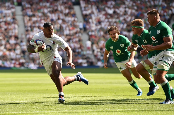 England's centre Manu Tuilagi (L) on his way to scoring a try during the international Test rugby union match between England and Ireland at Twickenham Stadium in west London on August 24, 2019. (Photo by Glyn KIRK / AFP)        (Photo credit should read GLYN KIRK/AFP/Getty Images)