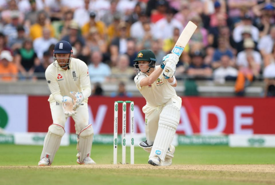 BIRMINGHAM, ENGLAND - AUGUST 04: Australia batsman Steven Smith hits out watched by Jonny Bairstow during day four of the First Specsavers Test Match between England and Australia at Edgbaston on August 04, 2019 in Birmingham, England. (Photo by Stu Forster/Getty Images)