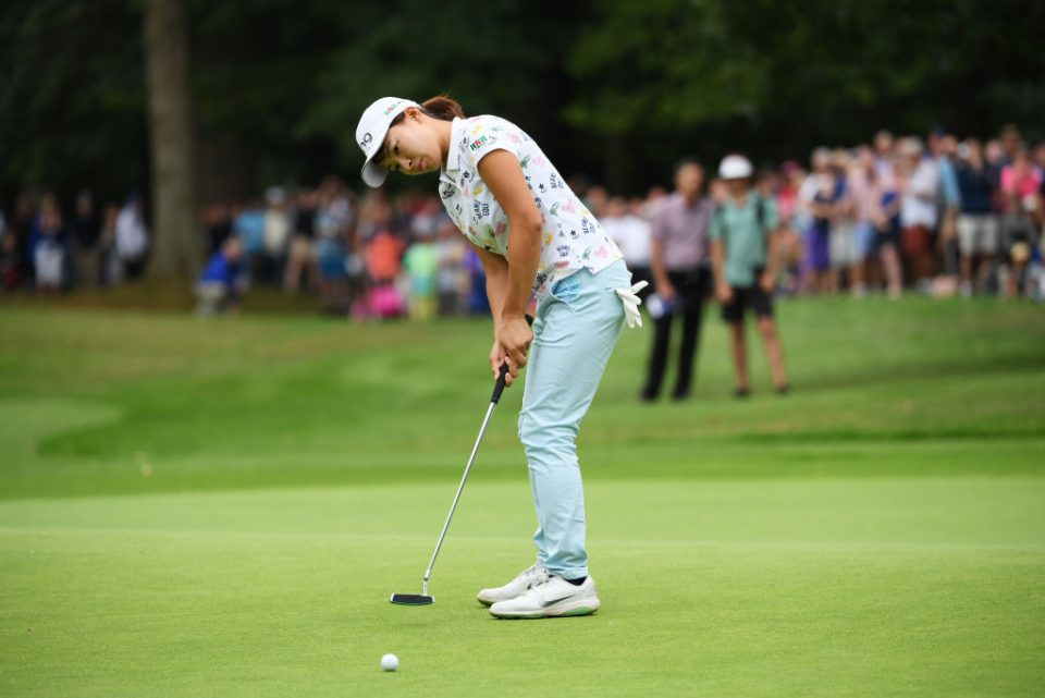 WOBURN, ENGLAND - AUGUST 04:  Hinako Shibuno of Japan holes the winning putt on the 18th green during Day Four of the AIG Women's British Open at Woburn Golf Club on August 04, 2019 in Woburn, England. (Photo by Ross Kinnaird/Getty Images)