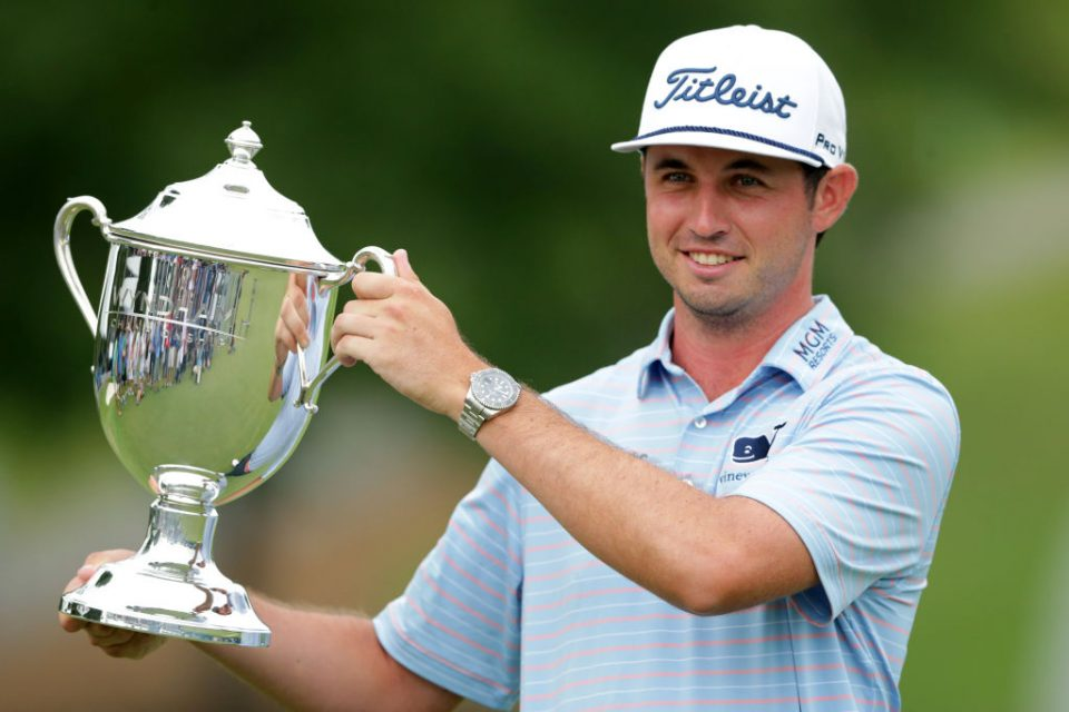 GREENSBORO, NORTH CAROLINA - AUGUST 04: J.T. Poston celebrates with the trophy after winning the Wyndham Championship at Sedgefield Country Club on August 04, 2019 in Greensboro, North Carolina. (Photo by Tyler Lecka/Getty Images)