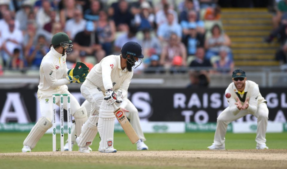 BIRMINGHAM, ENGLAND - AUGUST 05: Moeen Ali of England is caught out by David Warner of Australia during day five of the 1st Specsavers Ashes Test between England and Australia at Edgbaston on August 05, 2019 in Birmingham, England. (Photo by Gareth Copley/Getty Images)