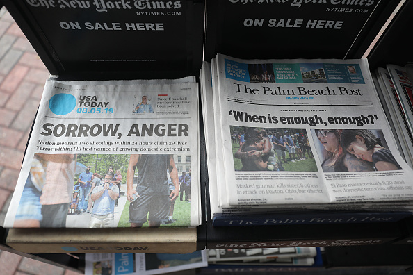 PALM BEACH, FLORIDA - AUGUST 05: A GateHouse Media owned Palm Beach Post and the Gannett Co. owned USA Today are seen for sale at a newsstand on August 05, 2019 in Palm Beach, Florida. GateHose Media announced an agreement to acquire Gannett Co. Inc, which would create the largest local news publishing organization in the U.S. (Photo by Joe Raedle/Getty Images)