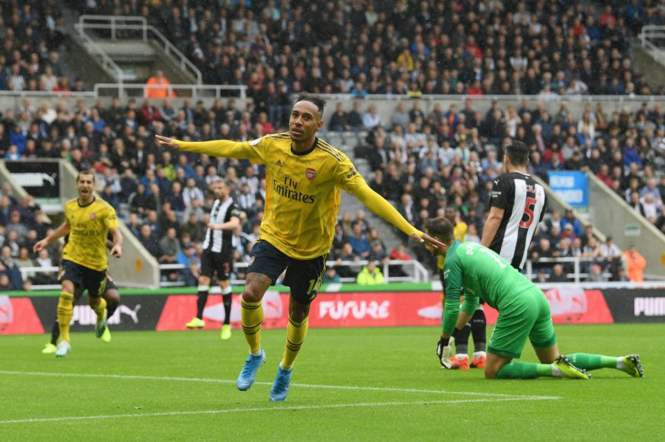 NEWCASTLE UPON TYNE, ENGLAND - AUGUST 11: Pierre-Emerick Aubameyang of Arsenal celebrates after scoring his team's first goal during the Premier League match between Newcastle United and Arsenal FC at St. James Park on August 11, 2019 in Newcastle upon Tyne, United Kingdom. (Photo by Stu Forster/Getty Images)