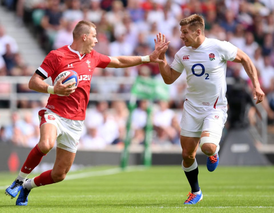 LONDON, ENGLAND - AUGUST 11: Liam Williams of Wales tries to hold off Piers Francis of England during the 2019 Quilter International match between England and Wales at Twickenham Stadium on August 11, 2019 in London, England. (Photo by Laurence Griffiths/Getty Images)
