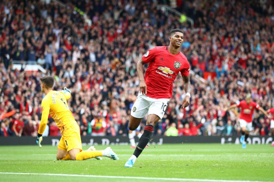 MANCHESTER, ENGLAND - AUGUST 11: Marcus Rashford of Manchester United celebrates after scoring his team's third goal during the Premier League match between Manchester United and Chelsea FC at Old Trafford on August 11, 2019 in Manchester, United Kingdom. (Photo by Julian Finney/Getty Images)