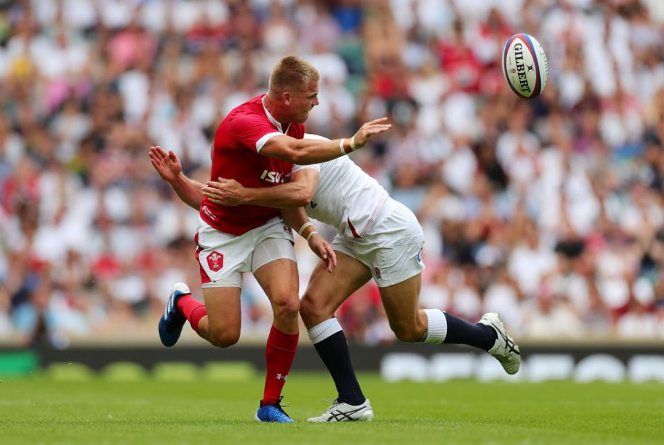 LONDON, ENGLAND - AUGUST 11:  Gareth Anscombe of Wales offloads under pressure from Willi Heinz of England during the 2019 Quilter International match between England and Wales at Twickenham Stadium on August 11, 2019 in London, England. (Photo by Dan Mullan/Getty Images)