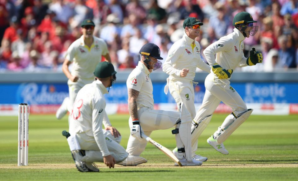 LONDON, ENGLAND - AUGUST 15: England batsman Ben Stokes reacts as Tim Paine (r) and Steve Smith (2nd r) celebrate after Nathan Lyon had taken his wicket during day two of the 2nd Test Match between England and Australia at Lord's Cricket Ground on August 15, 2019 in London, England. (Photo by Stu Forster/Getty Images)