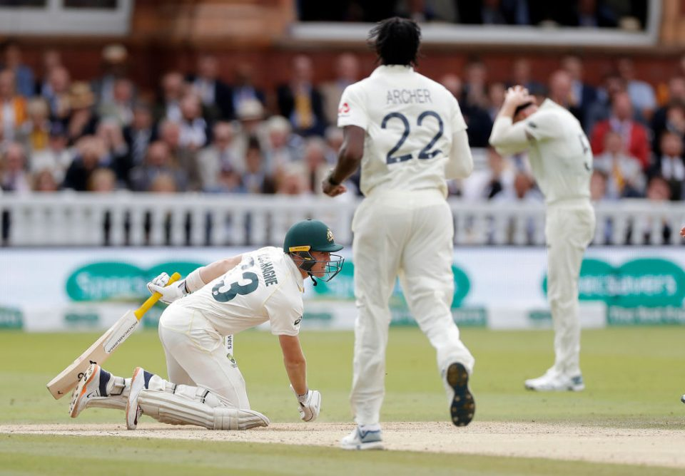 LONDON, ENGLAND - AUGUST 18: Marnus Labuschagne of Australia falls the the ground after being struck on the helmet by a delivery from Jofra Archer of England during day five of the 2nd Specsavers Ashes Test between England and Australia at Lord's Cricket Ground on August 18, 2019 in London, England. (Photo by Ryan Pierse/Getty Images)