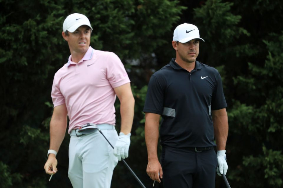 ATLANTA, GEORGIA - AUGUST 25: Brooks Koepka of the United States and Rory McIlroy of Northern Ireland look on from the eighth tee during the final round of the TOUR Championship at East Lake Golf Club on August 25, 2019 in Atlanta, Georgia. (Photo by Streeter Lecka/Getty Images)