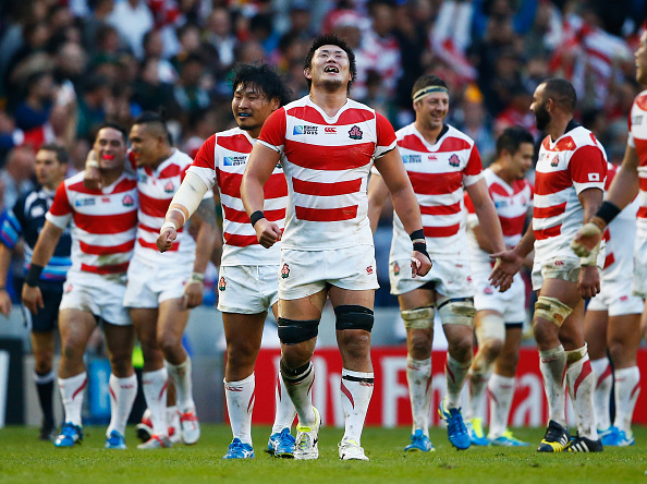 BRIGHTON, ENGLAND - SEPTEMBER 19:  Japan players celebrate their surprise victory during the 2015 Rugby World Cup Pool B match between South Africa and Japan at the Brighton Community Stadium on September 19, 2015 in Brighton, United Kingdom.  (Photo by Julian Finney/Getty Images)